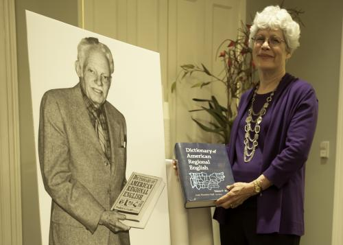 Hall poses next to a life-size cardboard photograph of Cassidy